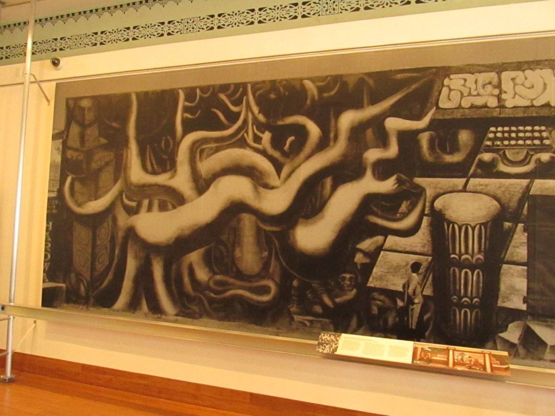 A replica of the America Tropical mural when it was first erected, complete with techno-enhanced presentation on its history.