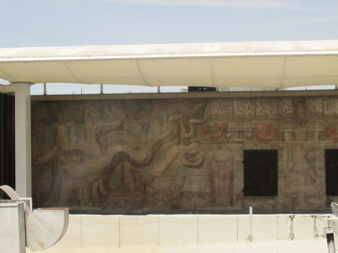 This is the actual mural after all the whitewashes has unjustly kept it hidden for many years.  It can be viewed on the roof level of the America Tropical Center.