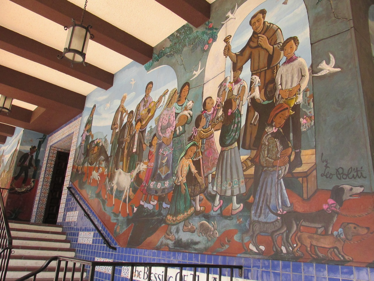A mural depicting the Blessing of the Animals, a Spanish tradition during the Easter season.  It's part of the historic Biscailuz Building.