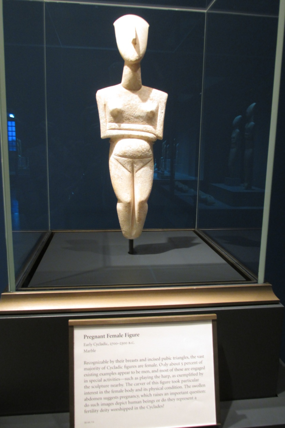 The figure from the ancient Cycladic Age.  Back then women were the boss.
